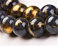 Jade Perlen, rund, schwarz-grau / gold gefärbt, 6 mm, 1 Strang